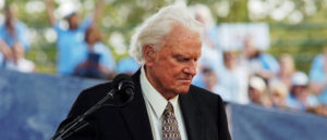 FILE PHOTO: Evangelist Billy Graham speaks during the final day of his Crusade at Flushing Meadows Park in New York June 26, 2005. REUTERS/Keith Bedford /File Photo - RC1256A59BC0